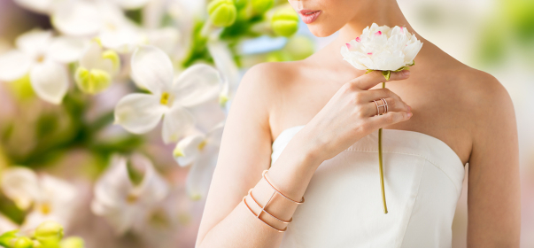 close up of beautiful woman with ring and bracelet