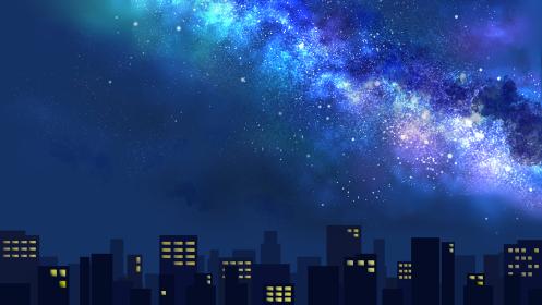 天の川が流れる夜空と光る街並み(ワイド)