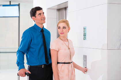 Couple waiting for hotel elevator or lift