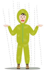 雨に打たれてビショビショになるカッパを来た残念そうな男性