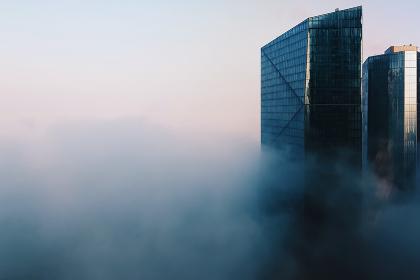 Dubai skyline with glass skyscrapers in fog