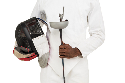 Mid-section of man standing with fencing mask and sword
