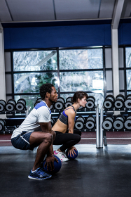 Fit couple exercising with medicine ball