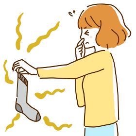臭い靴下を手に鼻をつまんで目をつぶる若い女性のイラスト