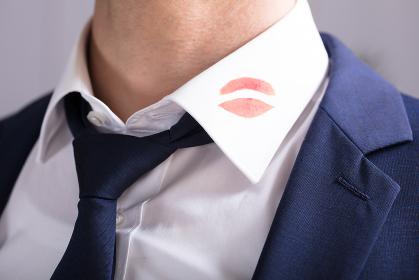 Businessman With Lipstick Kiss Marks On Shirt's Collar