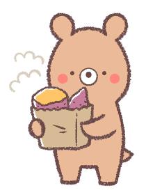 焼き芋を持つクマ