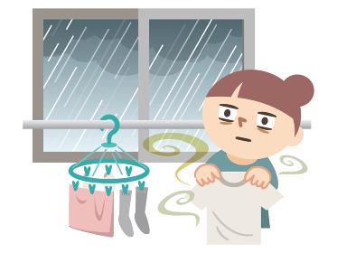 雨で洗濯物が干せずに呆然とする女性