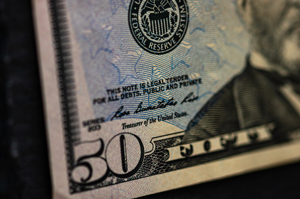 Selective focus on detail of 50 dollars banknote. Close up macro detail of money banknotes, dollars isolated. World money concept, inflation and economy concept
