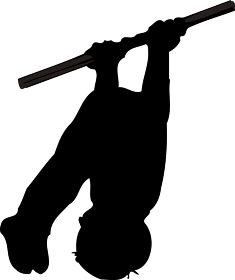 鉄棒の中抜きをしている人のシルエット