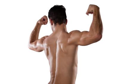 Rear view of sportsman flexing muscles