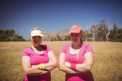 Two women standing together in the boot camp