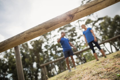 Fit people interacting with each other in boot camp