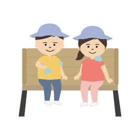 椅子に座って体を冷やしている男の子と女の子のイラスト