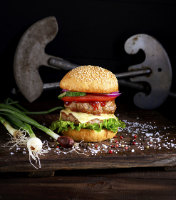 double burger with vegetables and cheese
