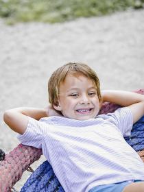 child,boy,boy plays on a children playground