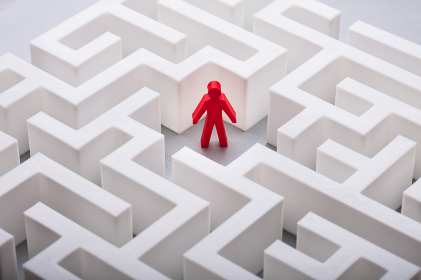 Red Human Figure Standing In The Centre Of Labyrinth