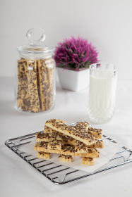 Gluten-free, Salted, Sesame, Sunflower Seeded Crispy Biscuit on a Whit