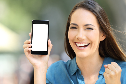 Excited woman showing a blank phone screen