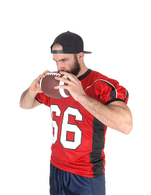 Football player holding his ball on his mouth thinking