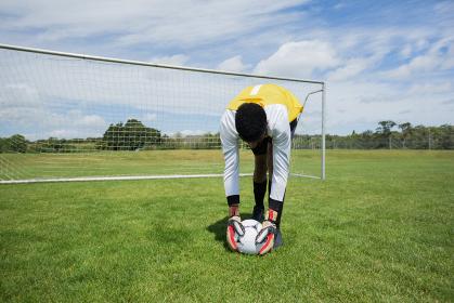 Goalkeeper ready to kick the soccer ball