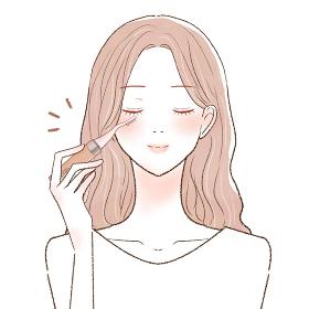ホットビューラーでまつ毛をカールさせる女性