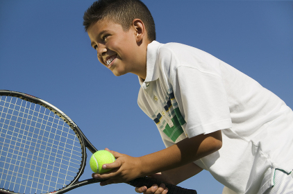 Young boy on tennis court Preparing to Serve close up low angle view