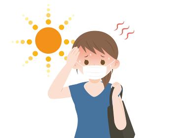 熱中症 猛暑の中マスクをつける女性