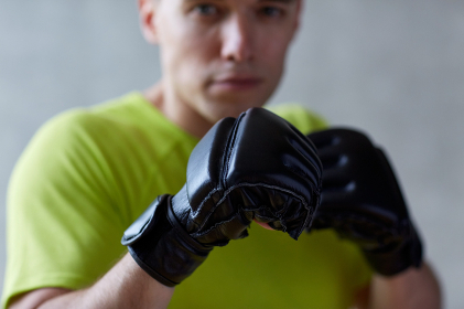 young man in boxing gloves indoors