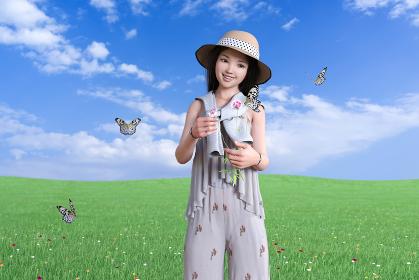 野原で1人の女の子が花を摘んでいるそばを蝶々が飛びまわる