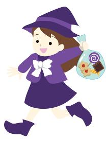 ハロウィン 魔女の仮装をしてお菓子をもらう女の子