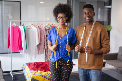 Diverse male and female fashion designers at work with tailor centimeters on necks. independent creative design business.