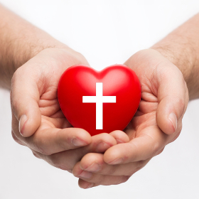 male hands holding heart with cross symbol