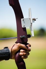 Close-up of athlete hand practicing archery