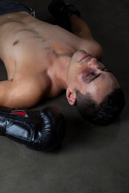 Boxer relaxing in boxing ring