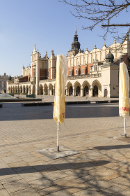 Main Market Square, a deserted city due to the coronavirus epidemic, no tourists, closed restaurants and shops, Krakow  Poland