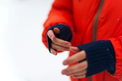 Woman  hands in orange jacket
