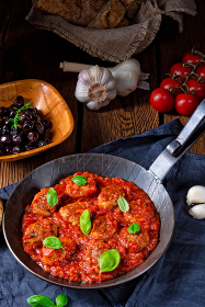 rustic mini meatballs baked in tomato sauce with basil