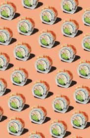 Pattern of rolls with prawn fillet on pinkish orange background