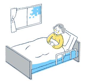 ベッドにいるおばあちゃん