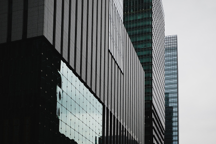 Urban Office Building Closeup with Cloudy Sky
