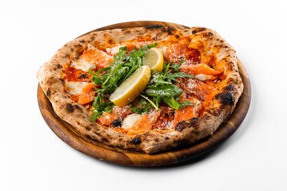 italian oven pizza with tomatoes, rucola, salmon and lemon , Rome, Lazio, Italy