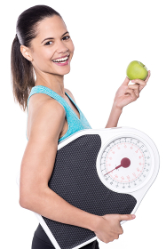 Happy lady posing with weighing scale and apple