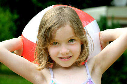 girl in the summer with a beach ball