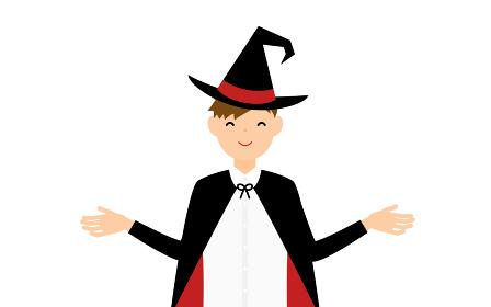 ハロウィンの仮装、魔法使い姿の男の子が両腕を広げるポーズ