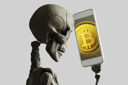 スマホでビットコインを見る骸骨