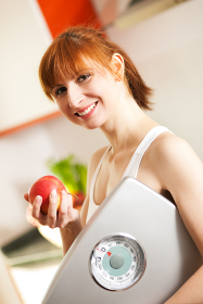 healthy eating - woman with scale