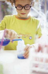 girl (8-9) in chemical lab,focus on girl in background