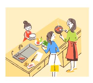 アイランドキッチンで調理をする女性