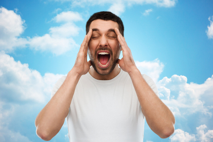 crazy shouting man in t-shirt over blue sky