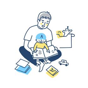 膝の上で抱っこしながら絵本を読む父と男の子